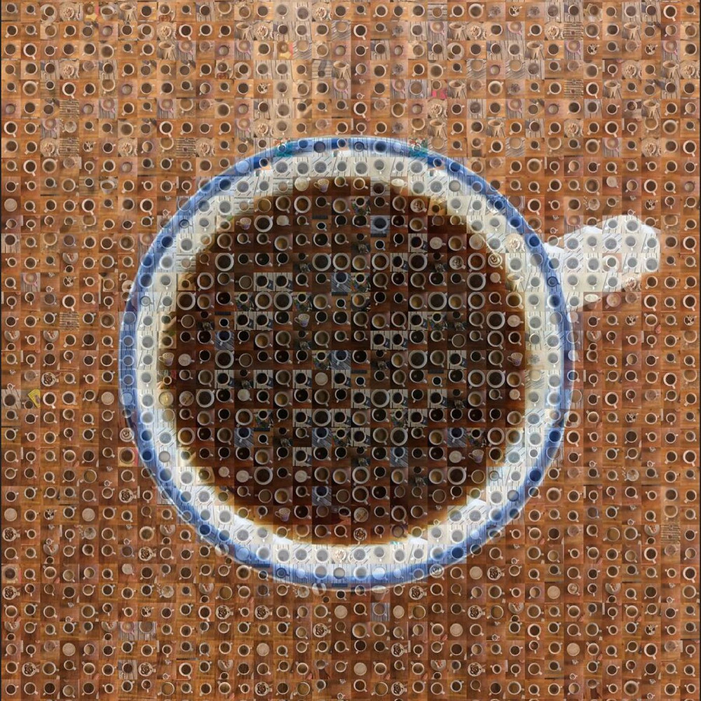 A mosaic of coffee cups creates one big image of a coffee cup, full, viewed from above. The cup is white with a blue rim, sitting on a brown table.