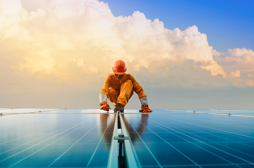 A man working at solar power station.jpg