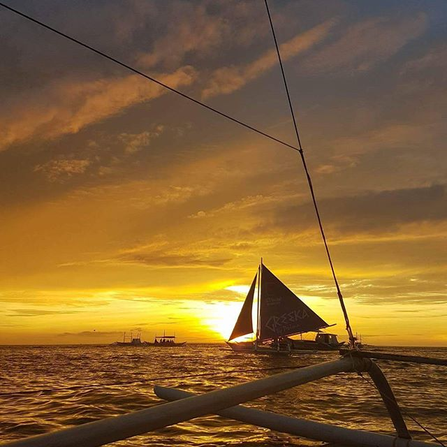 sailboat sunsets