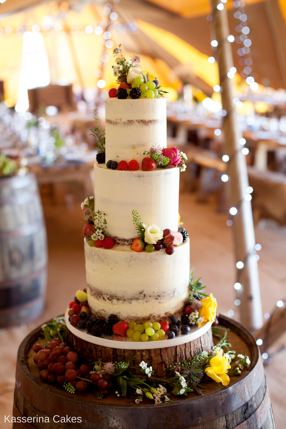 semi-naked wedding cake marquee wedding seminaked naked tiered cake sussex bride tent tipi festival