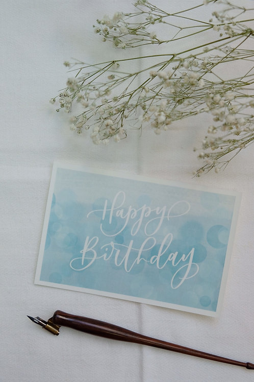 """Happy Birthday"" calligraphy blue watercolour style birthday postcard"