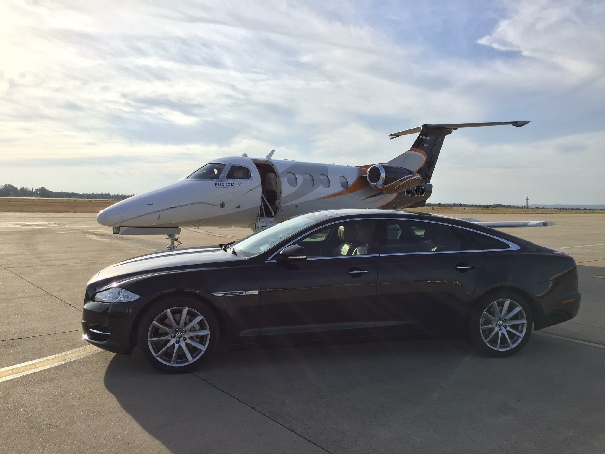 Car hire with chauffeur at the airport tarmac