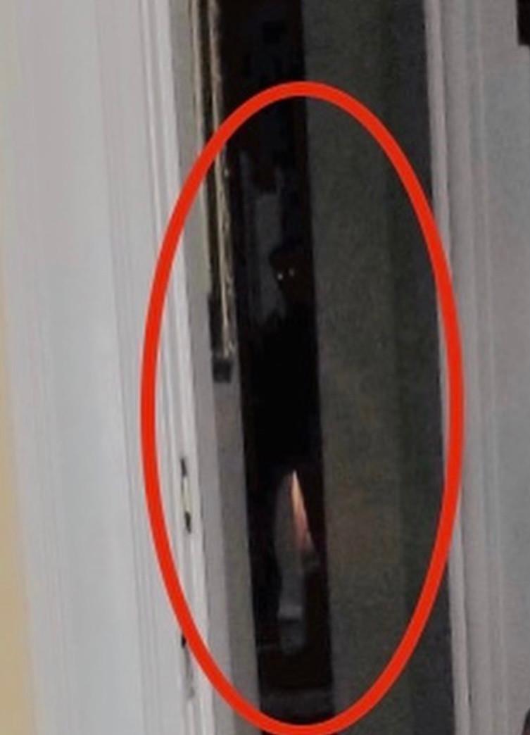 Glowing eyed ghost photo taken at McInteer Villa