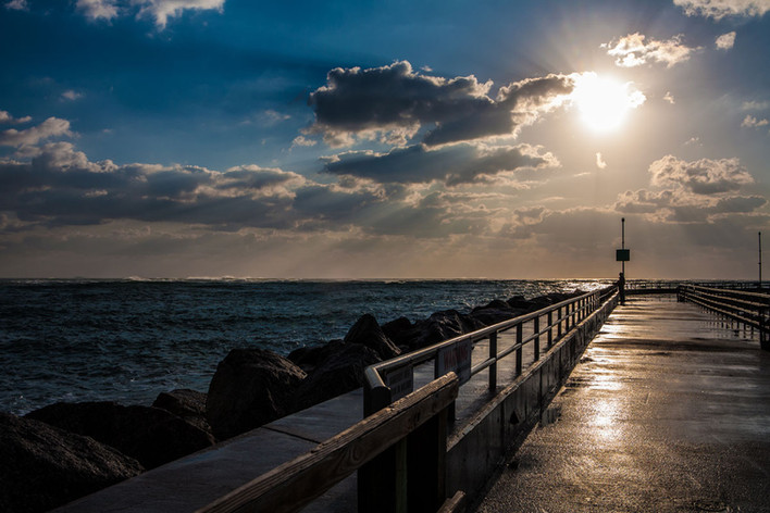 blue sunset over pier