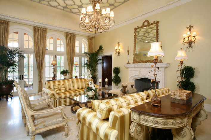 beige living room with striped gold sofas