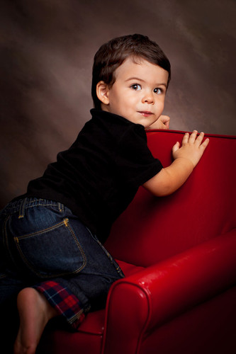 little kid on red chair