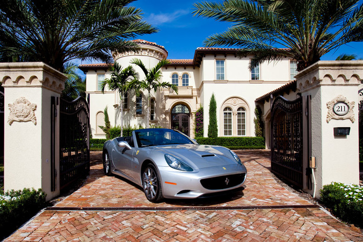 Ferrari in front of mansion