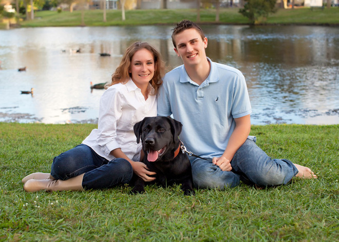 family with dog in grass