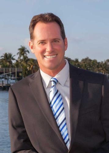 headshot of business man beach background