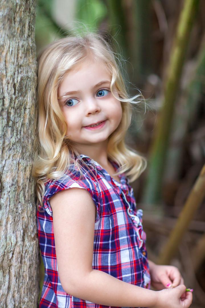 portrait of little girl in plaid