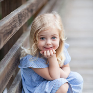 little girl with yellow shoes