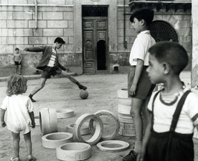 Boys playing soccer, Palermo, 1950