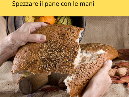 Spezzare il pane con le mani