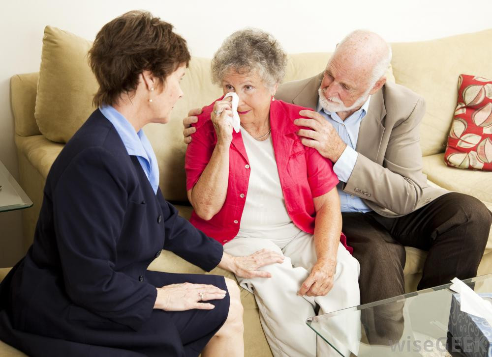 woman-and-elderly-man-console-crying-elderly-woman.jpg