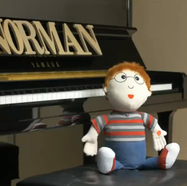 norman with piano