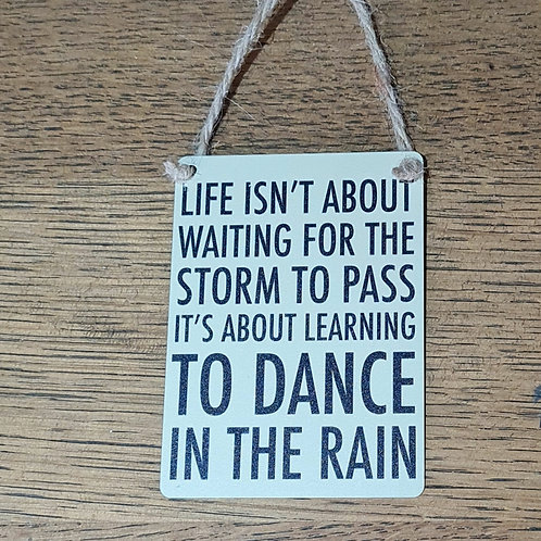 Life isn't about waiting for the Storm...Small Sign