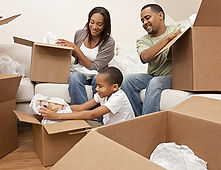 An entire family packing up boxes together