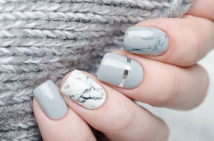 white grey marble manicure with silver s
