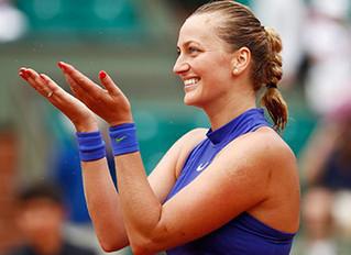 Kvitova scores emotional win in return from knife attack