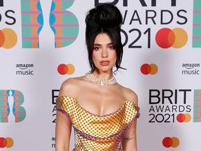 Dua Lipa's towering hairdo steals Brit Awards red carpet
