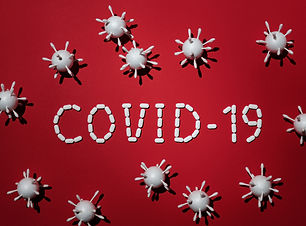 Red COVID sign - Photo by Edward Jenner
