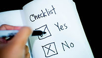 Person ticking checklist - Image from Pi