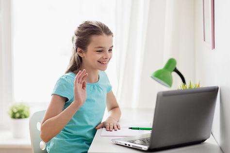 pretty girl waving at computer.jpeg