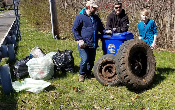 Volunteers cleaning up Old Trolley Way during the Trash Bash on April 21st.