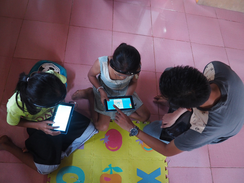 Students with their new tablets