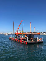 self-propelled crane barge with spud leg