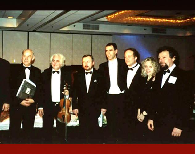 Dino-with-members-of-Sarajevo-Philharmonic, Michael and Sandy Bashaw, Bob Thompson