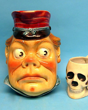 majolica character jug and skull cup