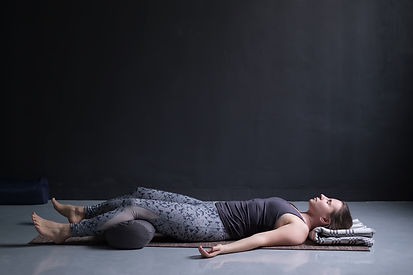 woman working out, doing yoga exercise o
