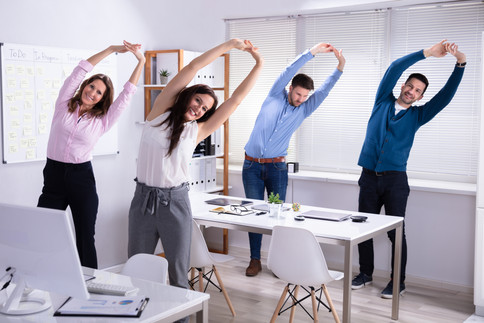 Happy Businesspeople Doing Stretching Ex