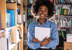 Portrait of young black female student .