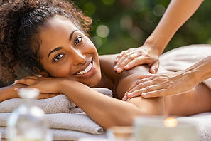 Happy woman relaxing with oil massage on
