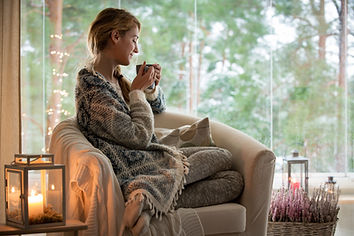Young beautiful woman sitting home in th