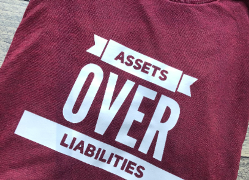 Assets OVER Liabilities Shirt