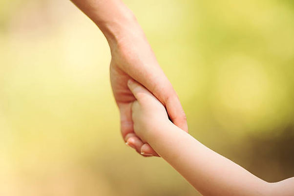 Mother and child holding hands.jpg