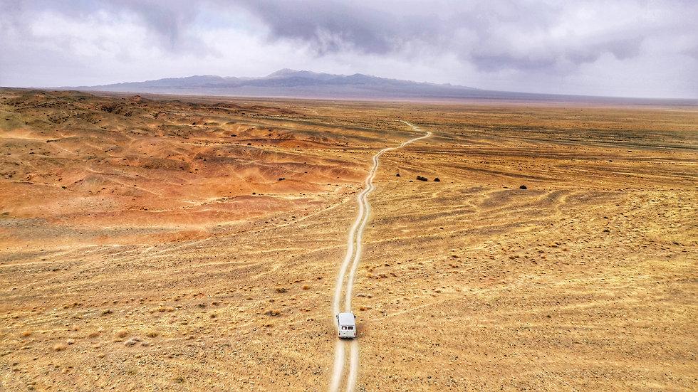 white-van-on-desert-2689649 (1).jpg