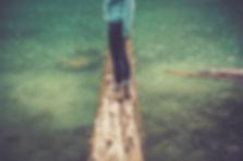 Woman balancing on log.jpg