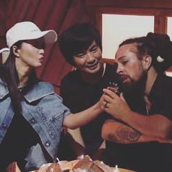 Tan WeiWei, Ge Fei and me hamming it up, talking into her broken shoe like it's a microphone.jpg Goo