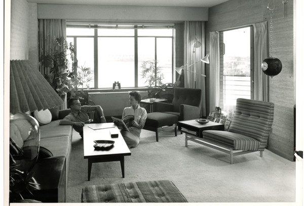 """Ann and Bill in their living room. Ann's memory: """"The photographer told us to sit on the floor and pose like that. Take a good look at that living room. Do you think we ever sat on the floor?"""""""