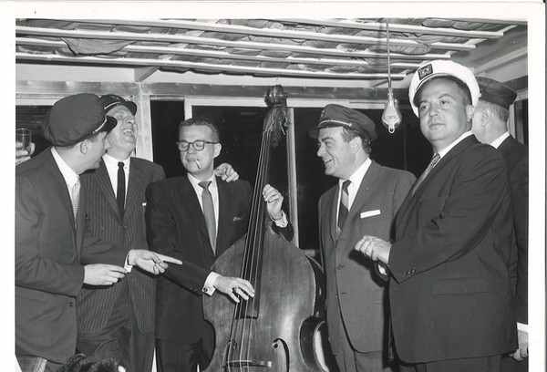 """The man in the pinstriped jacket with an arm around Bill is """"I've Got a Secret"""" executive producer Gil Fates. Allan Sherman is on the far right."""