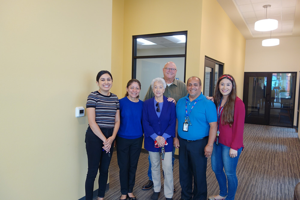 From left to right: Tanya Ortiz (Program Manager, 1010 Development), Rosa Sosa (Property Manager, Barker MGNT), Carmen Vaughn, Hector Sanchez (Case Manager, PATH), Charity Mostafa (Intensive Case Manager, PATH); In the back: Bob Buente (President/CEO, 1010 Development); Photo by: Sheena Rodriguez (Program Director, 1010 Development)
