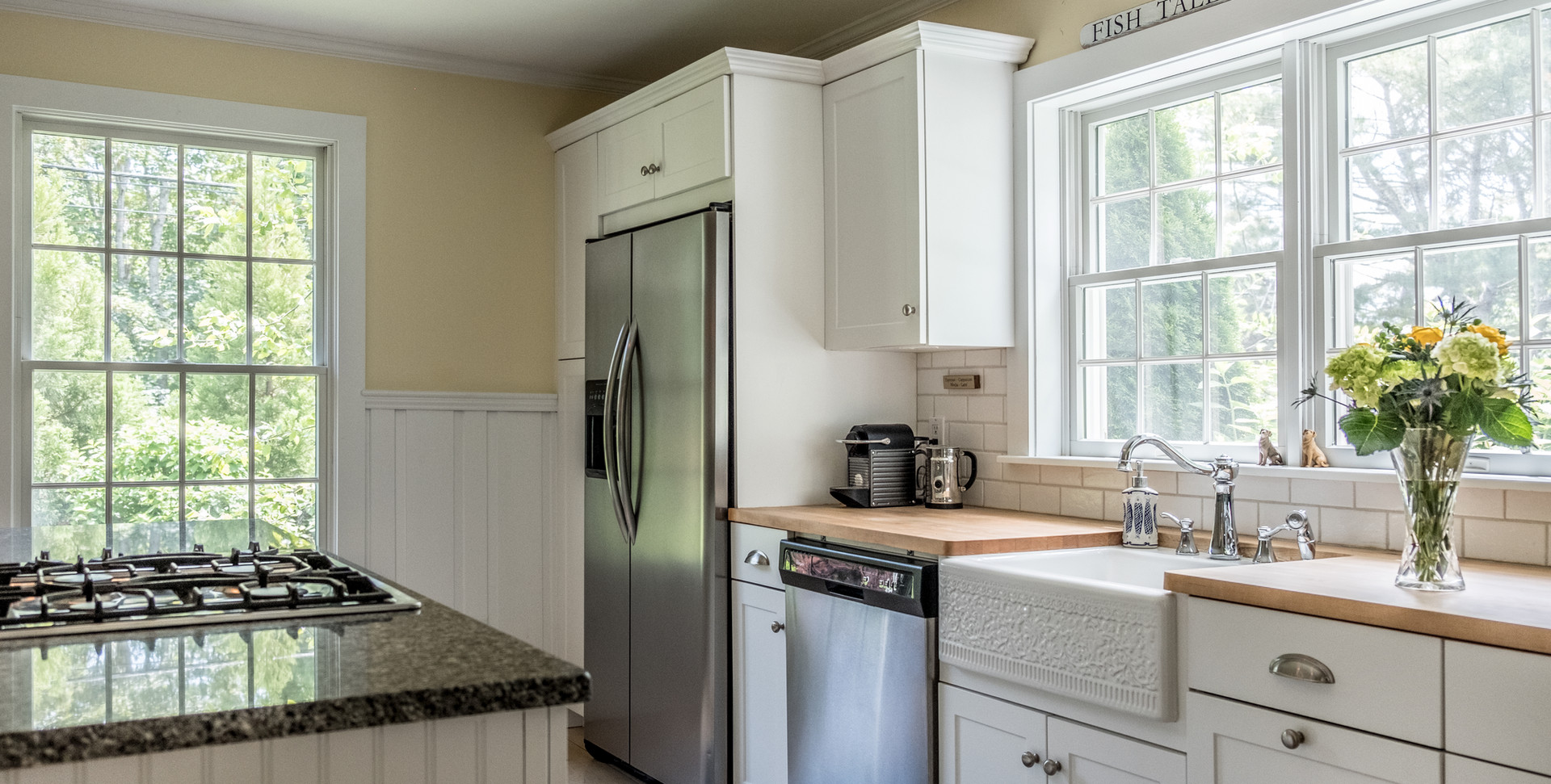 Cape Cod Kitchen with Stainless Steel Appliances