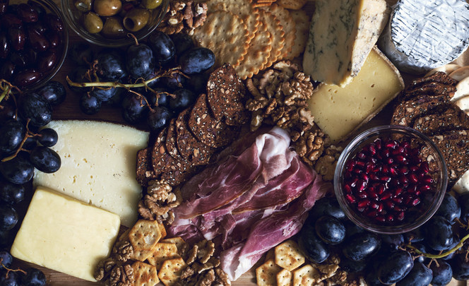a-platter-of-meats-and-cheeses-fit-for-r