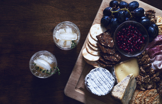 a-cheese-and-fruit-board-with-cocktails.