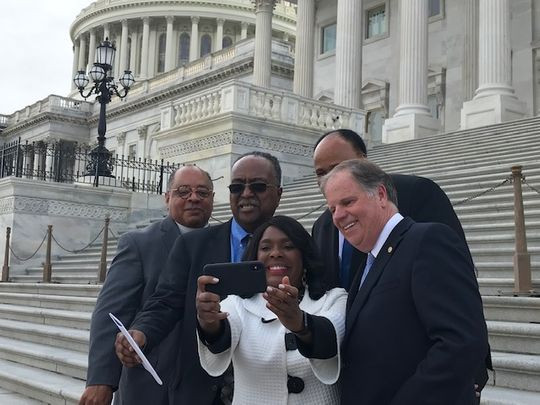 Rep. Terri Sewell, D-Ala., takes a selfie with Rev. Canon Leonard L. Hamlin, Sr. of the National Washington Cathedral, Charles Steele, president of the Southern Christian Leadership Conference, Sen. Doug Jones, D-Ala., and Martin Luther King III, April 9, 2019. (Photo: Deborah Barfield Berry, USA TODAY)
