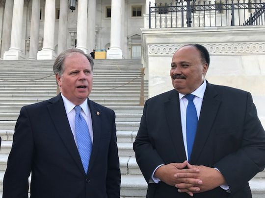 """Sen. Doug Jones, D-Ala., and Martin Luther King III talk to reporters April 9, 2019 after a bipartisan group of senators read Martin Luther King's """"Letter from Birmingham Jail'' on the Senate floor. (Photo: Deborah Barfield Berry, USA TODAY)"""